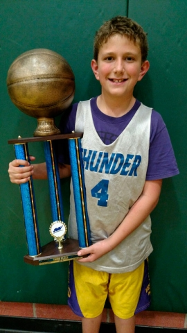 championship trophy and basketball player