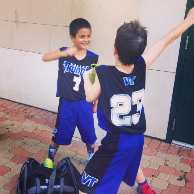 Kids dancing in basketball uniforms